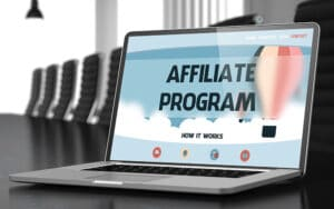Open laptop with affiliate program on the screen