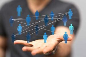 Hand with people networking hovering on top