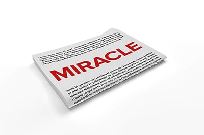 Miracle written on top of white paper